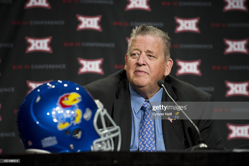 Kansas head coach <a gi-track='captionPersonalityLinkClicked' href=/galleries/search?phrase=Charlie+Weis&family=editorial&specificpeople=631229 ng-click='$event.stopPropagation()'>Charlie Weis</a> speaks during the Big 12 Media Day on July 21, 2014 at the Omni Hotel in Dallas, Texas.