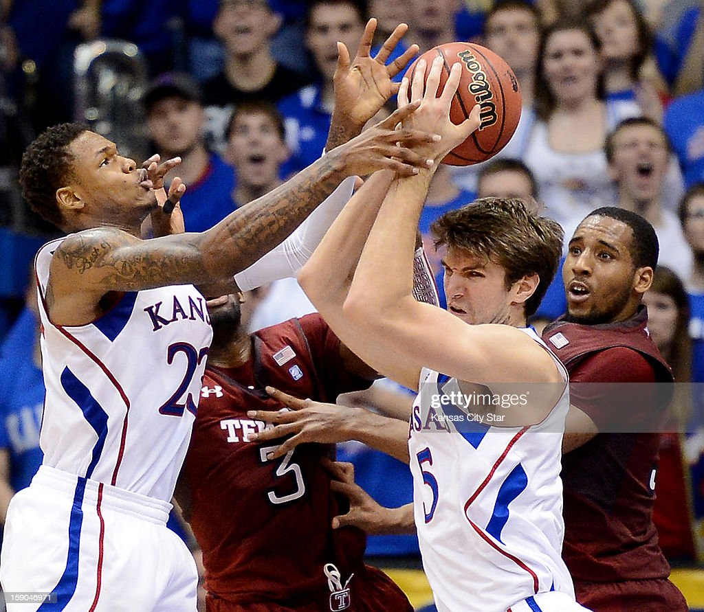 Kansas Jayhawks' Ben McLemore, left, and Jeff Withey grab a rebound during the second half of a college basketball game against the Temple Owls at Allen Fieldhouse on Sunday, January 6, 2012, in Lawrence, Kansas. The University of Kansas defeated Temple University, 69-62.