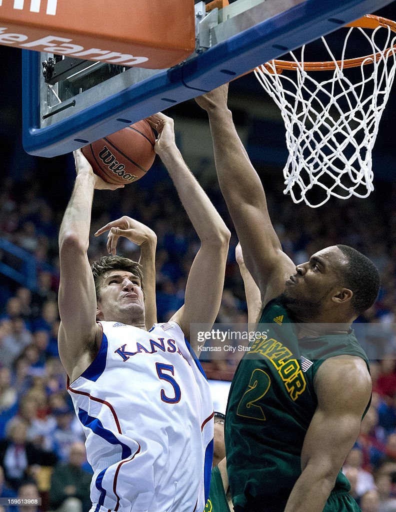 Kansas Jayhawks center Jeff Withey (5) muscles the ball to the basket against Baylor Bears forward Rico Gathers (2) in the second half during Monday's basketball game on January 14, 2013, in Lawrence, Kansas.