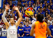Kansas Jayhawks fan takes a selfie with mascot Big Jay during the game between the Oklahoma State Cowboys and the Kansas Jayhawks at Allen Fieldhouse...