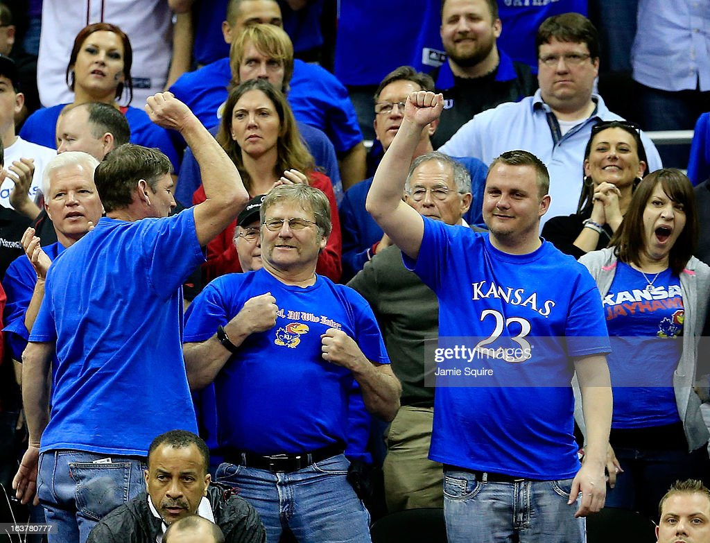 Kansas Jayhawks fans cheer in the second half of the game against the Iowa State Cyclones during the Semifinals of the Big 12 basketball tournament at the Sprint Center on March 15, 2013 in Kansas City, Missouri. Kansas won 88-73 over Iowa State.