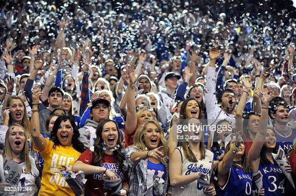 Kansas Jayhawks fans cheer on their team as they are introduced prior to a game against the Texas Longhorns in the first half at Allen Field House on...