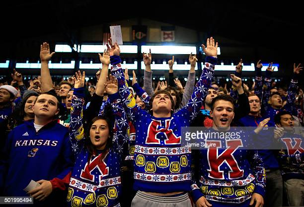 Kansas Jayhawks fans wearing ugly Christmas Sweaters cheer prior to the game against the Montana Grizzlies at Allen Fieldhouse on December 19 2015 in...