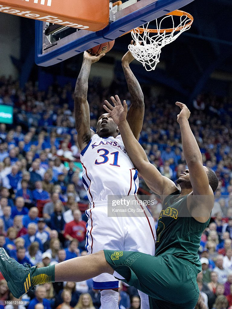 Kansas Jayhawks forward Jamari Traylor (31) puts a shot back up over Baylor Bears guard Gary Franklin (4) in the first half during Monday's basketball game on January 14, 2013, in Lawrence, Kansas.