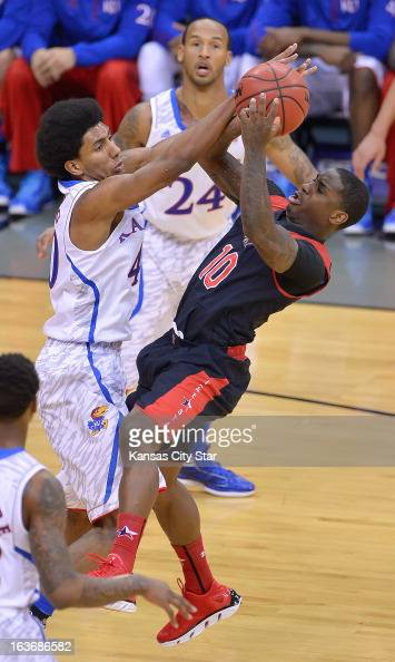 Kansas Jayhawks forward Kevin Young blocks a shot attempt by Texas Tech Red Raiders guard Daylen Robinson during the first half in the men's Big 12...