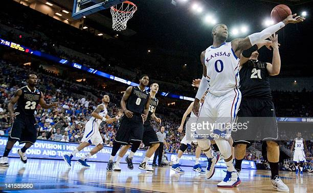 Kansas Jayhawks forward Thomas Robinson and Purdue Boilermakers guard/forward DJ Byrd fought for a rebound during the first half in Sunday's...