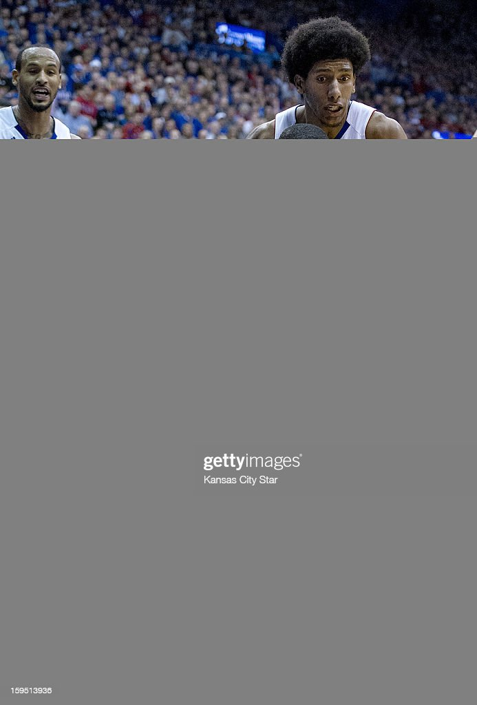 Kansas Jayhawks guard Ben McLemore dives for the ball in front of Baylor Bears guard AJ Walton and Kansas Jayhawks forward Kevin Young in the second...