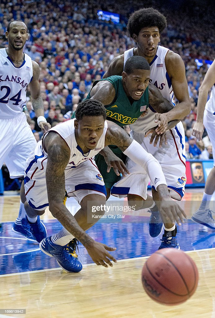 Kansas Jayhawks guard Ben McLemore (23) dives for the ball in front of Baylor Bears guard A.J. Walton (22) and Kansas Jayhawks forward Kevin Young (40) in the second half during Monday's basketball game on January 14, 2013, in Lawrence, Kansas.