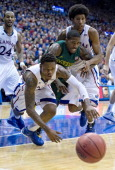 Kansas Jayhawks guard Ben McLemore dives for the ball in front of Baylor Bears guard AJ Walton and Kansas Jayhawks forward Kevin Young in the second...