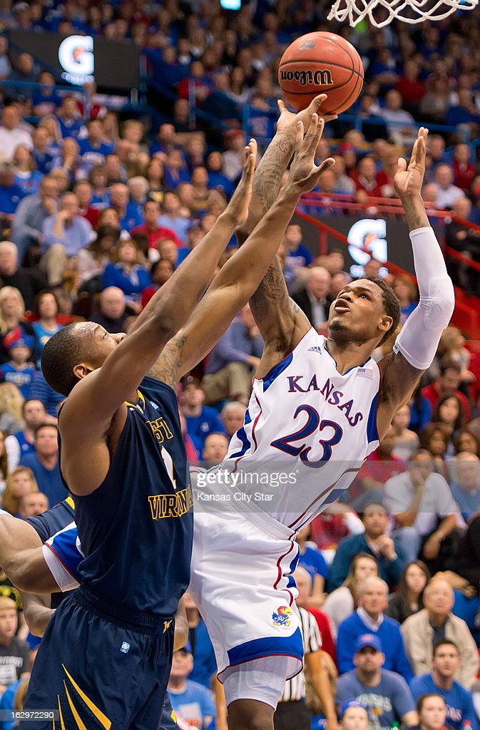 Kansas Jayhawks guard Ben McLemore (23) sinks two of his 36 points on this shot over West Virginia Mountaineers forward Dominique Rutledge (1) at Allen Fieldhouse in Lawrence, Kansas, Saturday, March 2, 2013. Kansas defeated West Virginia, 91-65.