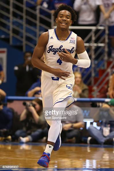 Kansas Jayhawks guard Devonte' Graham after making a three point shot in an NCAA basketball game between the Long Beach State 49ers and the Kansas...