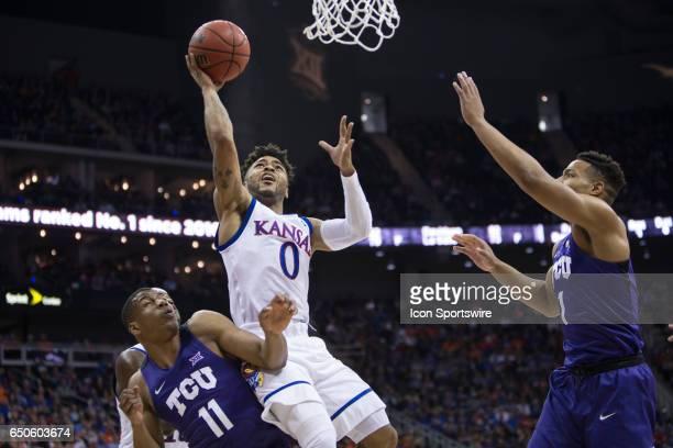 Kansas Jayhawks guard Frank Mason III puts up a shot during the Big 12 conference mens basketball tournament game between the Kansas Jayhawks and the...