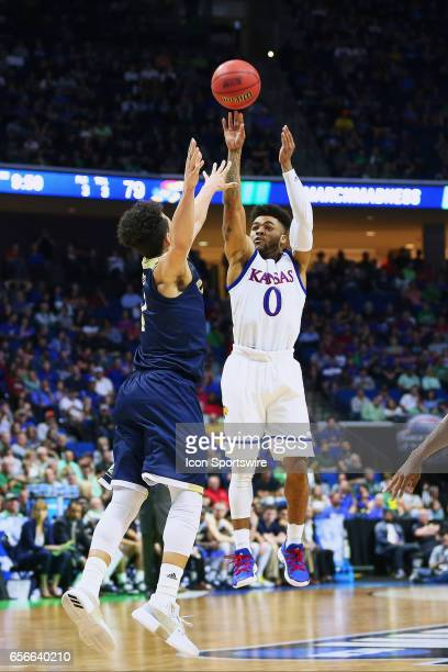 Kansas Jayhawks Guard Frank Mason III takes a three point jump shot during the Kansas Jayhawks game versus the UC Davis Aggies in the first round of...