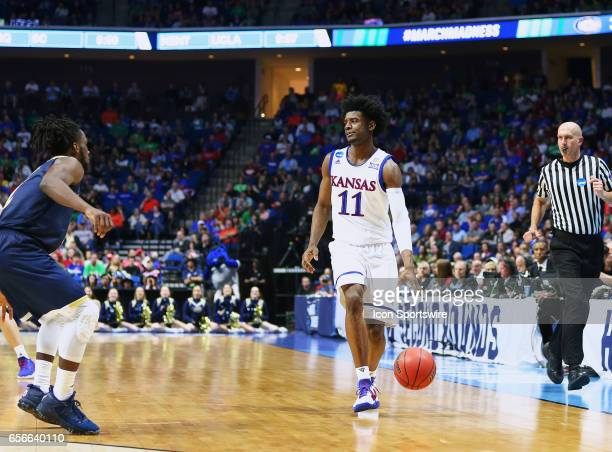 Kansas Jayhawks Guard Josh Jackson surveys the defense of the Aggies during the Kansas Jayhawks game versus the UC Davis Aggies in the first round of...