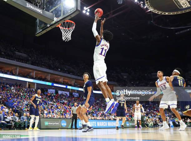 Kansas Jayhawks Guard Josh Jackson takes the lob pass from Kansas Jayhawks Guard Frank Mason III and converts for the score during the first round of...