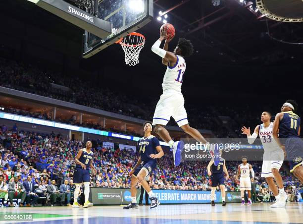 Kansas Jayhawks Guard Josh Jackson takes the lob pass from Kansas Jayhawks Guard Frank Mason III and converts for the score during the Kansas...