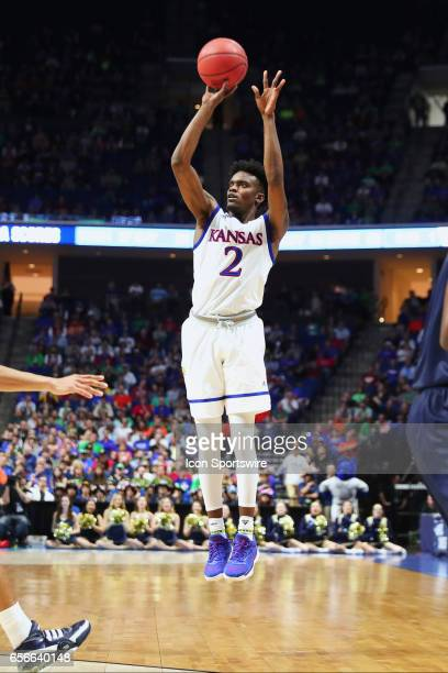 Kansas Jayhawks Guard Lagerald Vick elevates high on his three point shot attempt during the Kansas Jayhawks game versus the UC Davis Aggies in the...