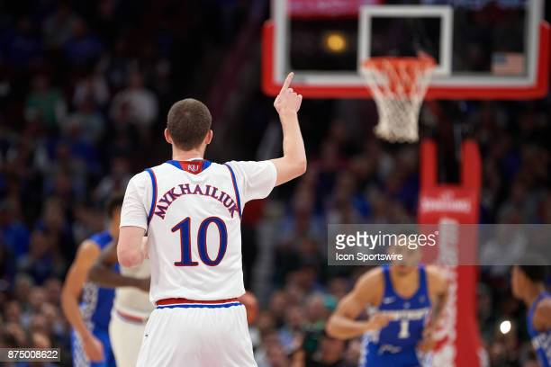 Kansas Jayhawks guard Sviatoslav Mykhailiuk points to teammates after making a three point basket during the State Farm Classic Champions Classic...