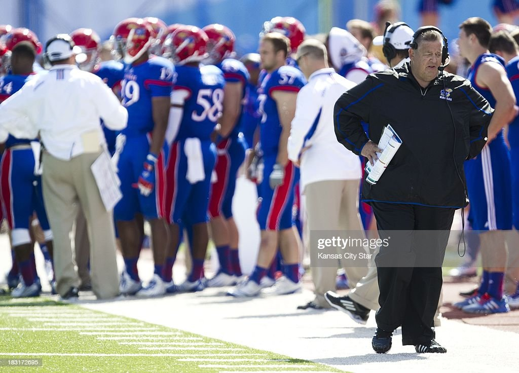 Kansas Jayhawks head coach Charlie Weis paces the sidelines during the second half against Texas Tech at Memorial Stadium in Lawrence, Kansas, Saturday, October 5, 2013. Texas Tech defeated Kansas, 56-16.