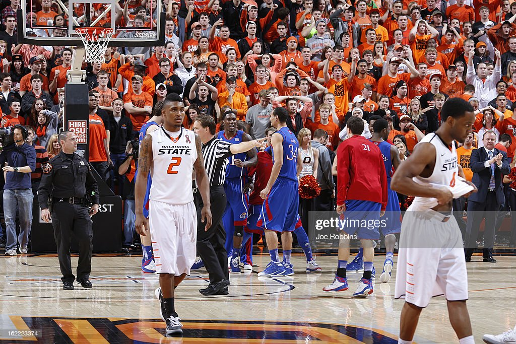 Kansas Jayhawks players celebrate at the end of the game against the Oklahoma State Cowboys at Gallagher-Iba Arena on February 20, 2013 in Stillwater, Oklahoma. Kansas won 68-67 in two overtimes.