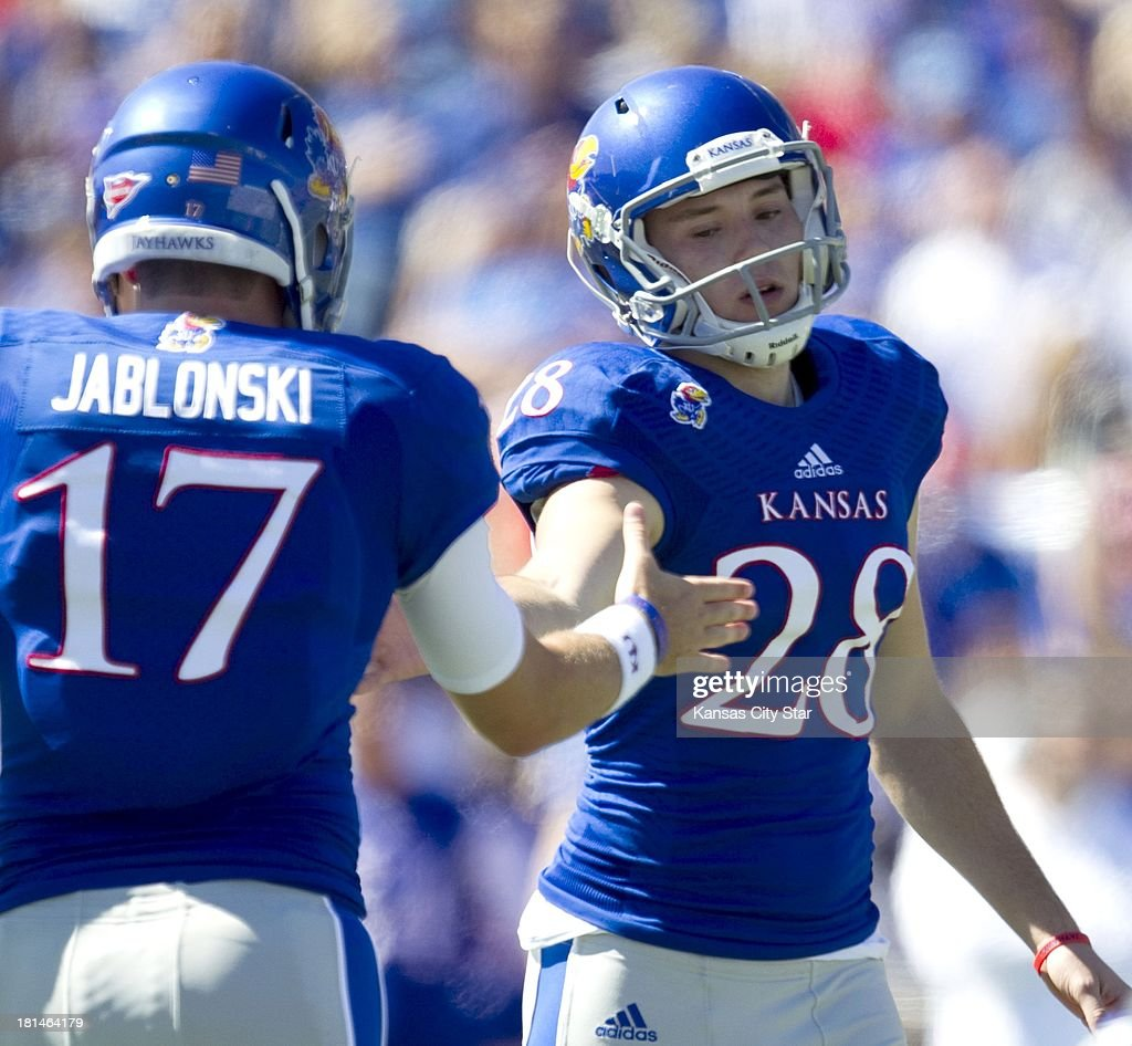 Kansas Jayhawks quarterback Blake Jablonski (17) slaps hands with Kansas Jayhawks kicker Matthew Wyman (28) after Wyman hit a field goal in the first half against Louisiana Tech at Memorial Stadium in Lawrence, Kansas, on Saturday, September 21, 2013. The Kansas Jayhawks defeated the Louisiana Tech Bulldogs, 13-10.