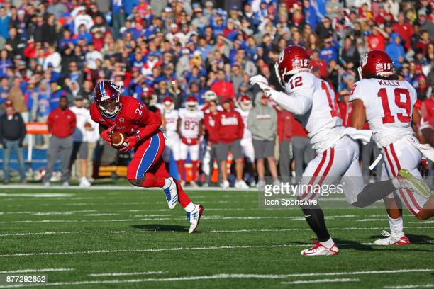Kansas Jayhawks running back Taylor Martin tries to recover after a snap over his head in the first quarter of a Big 12 game between the Oklahoma...