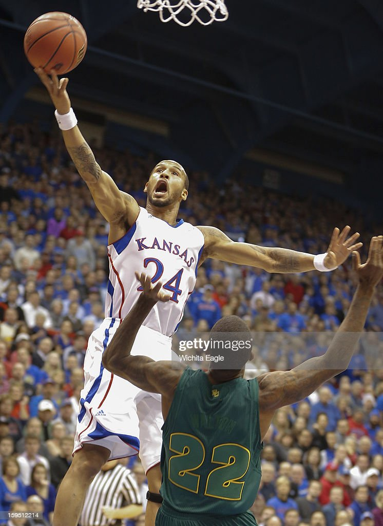 Kansas Jayhawks' Travis Releford goes up for a shot over Baylor Bears' A.J. Walton during the first half at Allen Field House on Monday, January 14, 2013, in Lawrence, Kansas.