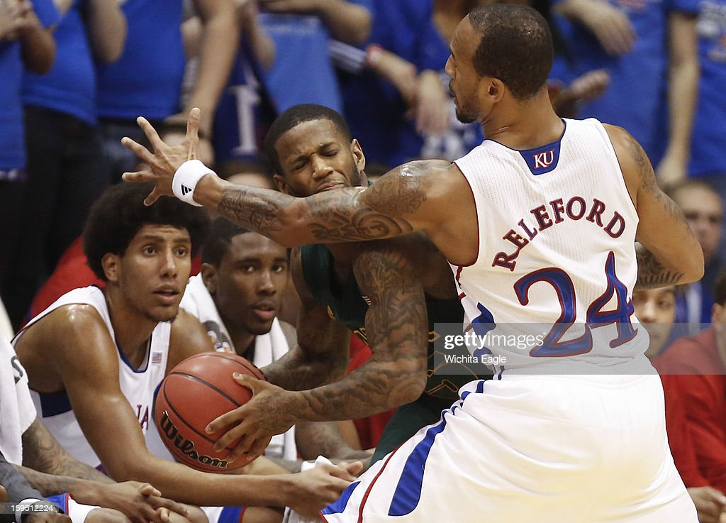 Kansas Jayhawks' Travis Releford, right, defends Baylor Bears' Pierre Jackson during the first half at Allen Field House on Monday, January 14, 2013, in Lawrence, Kansas.