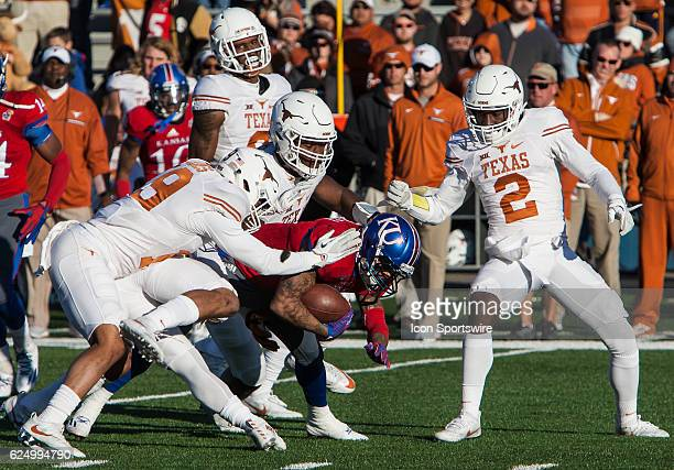 Kansas Jayhawks wide receiver LaQuvionte Gonzalez is swarmed by Texas Longhorns cornerback Kris Boyd and other Texas defenders during the game...