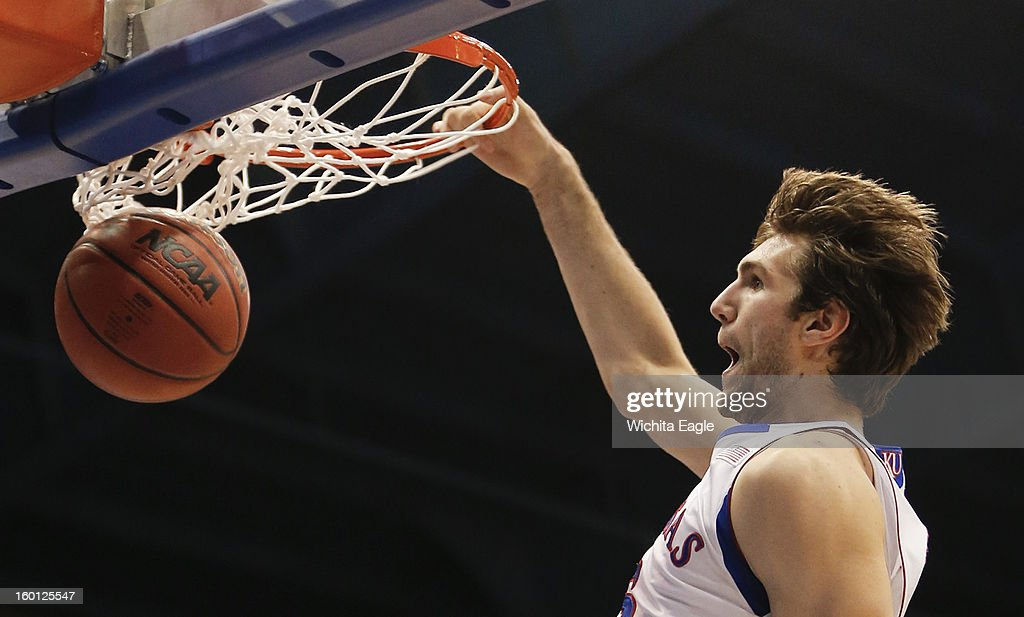 Kansas' Jeff Withey dunks during the second half against Oklahoma at Allen Fieldhouse in Lawrence, Kansas, on Saturday, January 26, 2013. Kansas won, 67-54.