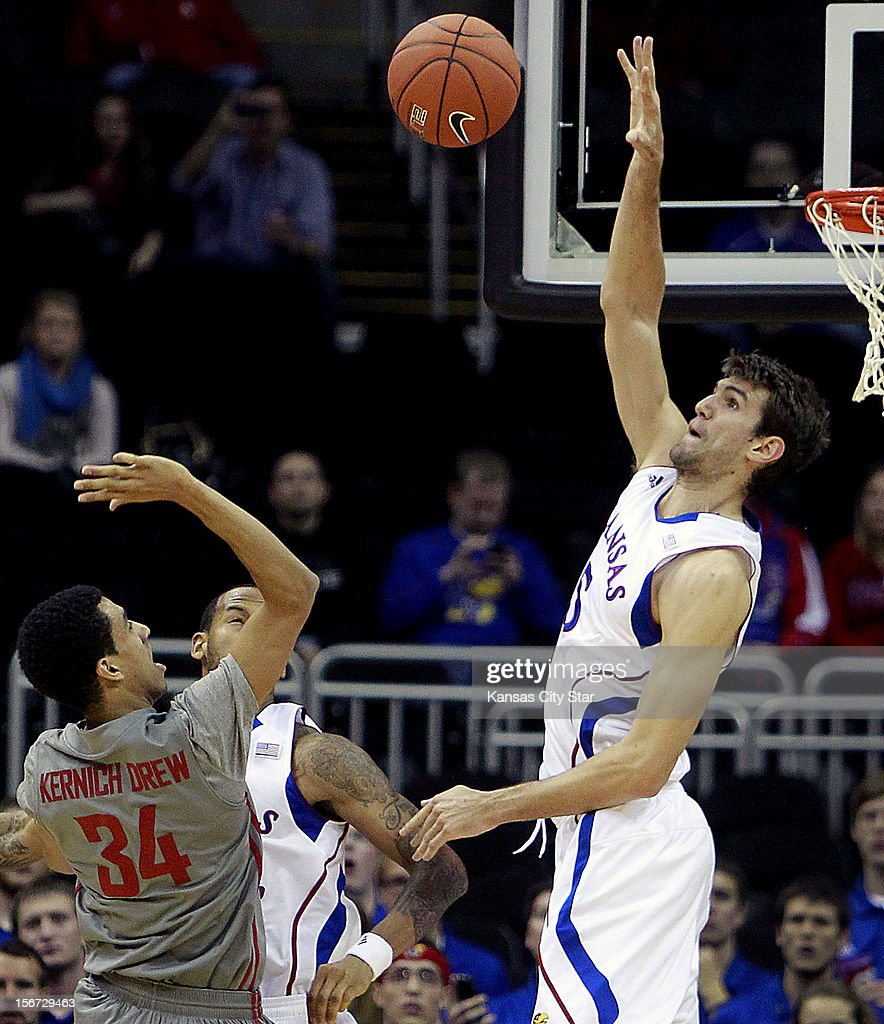 Kansas' Jeff Withey swats a shot taken by Washington State's Dexter Kenrich-Drew during the first half of the CBE Hall of Fame Classic at the Sprint Center on Monday, November 19, 2012, in Kansas City, Missouri.