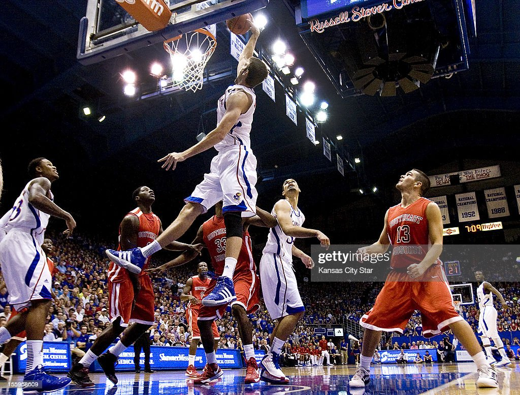 Kansas' Jeff Withey takes a high rebound out of mid-air and slams it down with authority during the opening minutes against Southeast Missouri State at Allen Fieldhouse in Lawrence, Kansas, on Friday, November 9, 2012. KU won, 74-55.