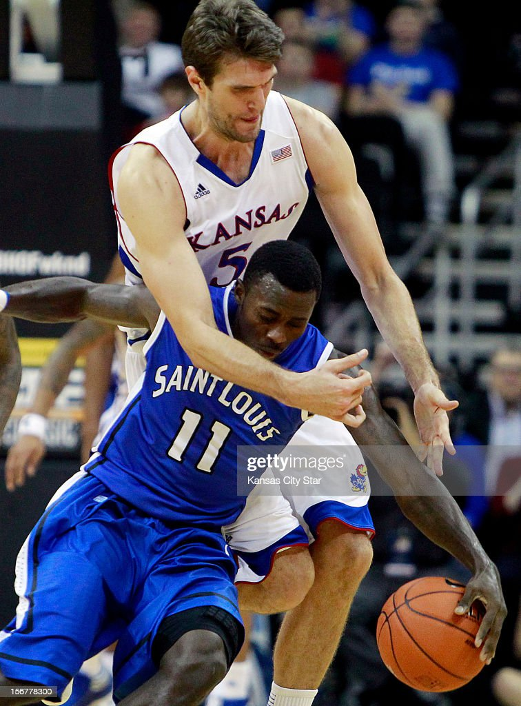 Kansas' Jeff Withey tries going over the top of Saint Louis' Mike McCall (11) for a loose ball during the first half in the championship of the CBE Hall of Fame Classic at the Sprint Center in Kansas City, Missouri, on Tuesday, November 20, 2012. Kansas defeated Saint Louis, 73-59.