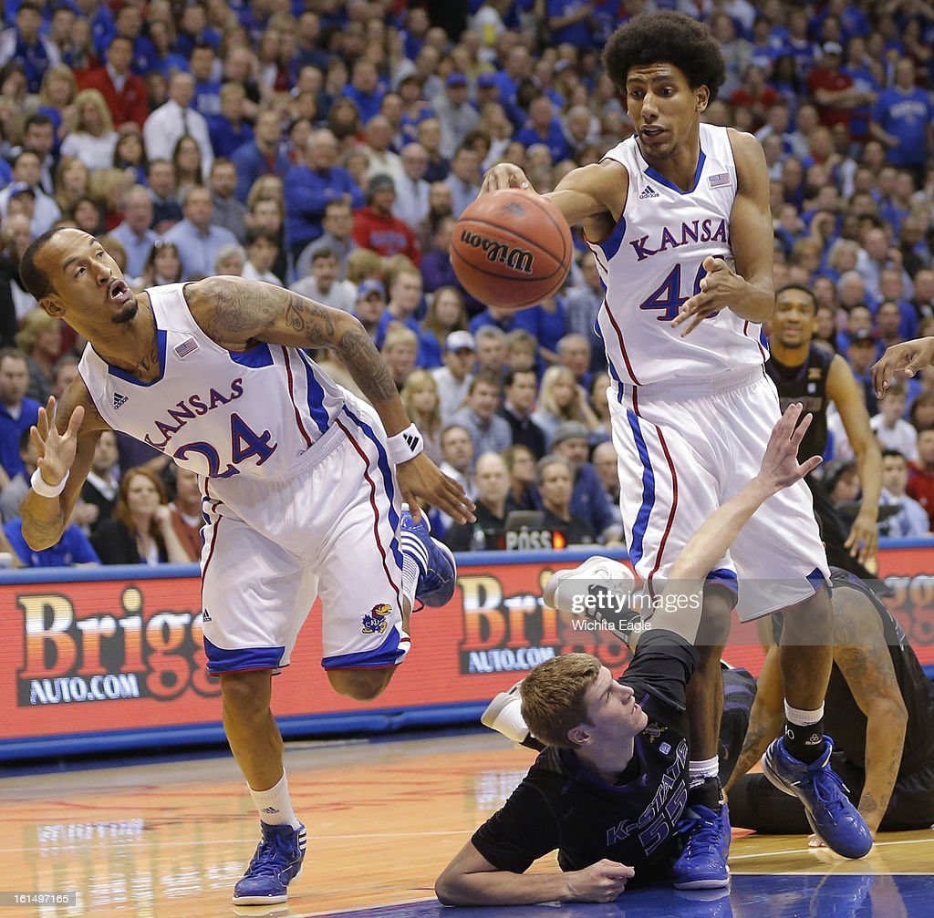 Kansas' Kevin Young and Travis Releford try and advance the ball against Kansas State's Will Spradling during the first half at Allen Fieldhouse in Lawrence, Monday, February 11, 2013.