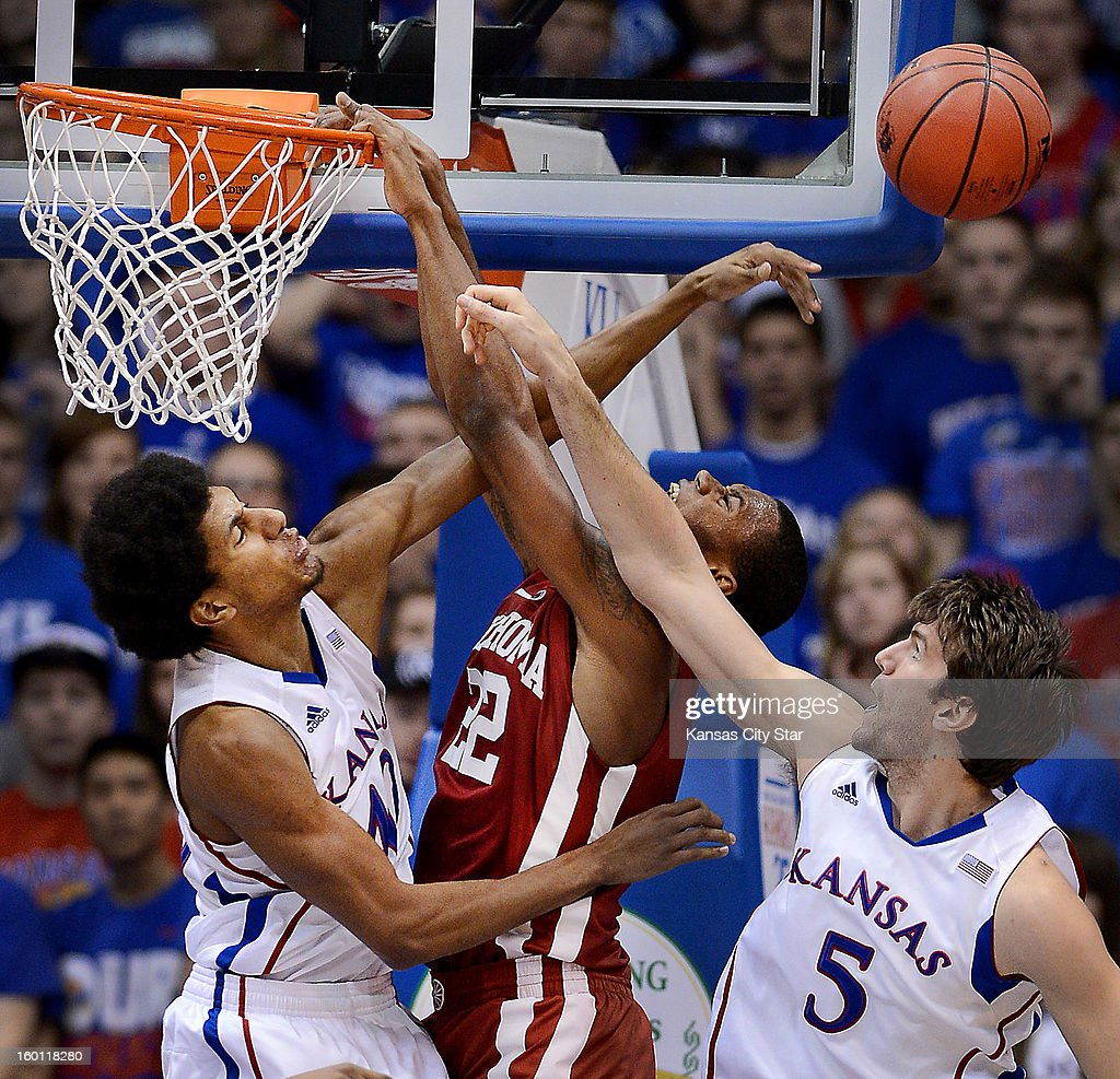 Kansas' Kevin Young, left, and teammate Jeff Withey (5) reject a dunk attempt by Oklahoma's Amath M'Baye during the second half at Allen Fieldhouse in Lawrence, Kansas, on Saturday, January 26, 2013. Kansas won, 67-54.