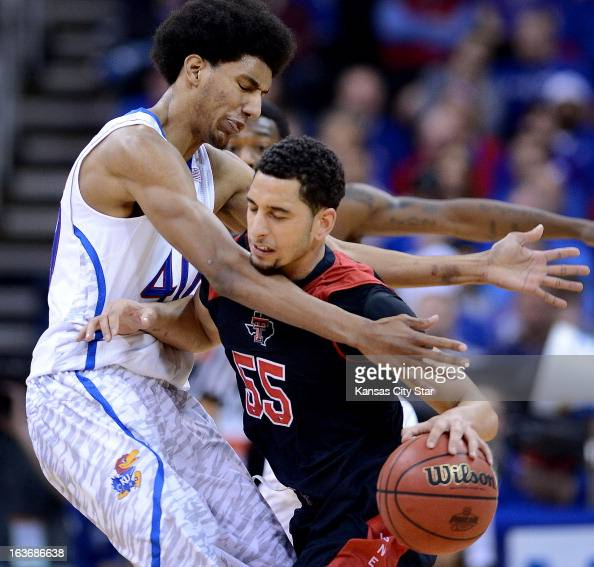 Kansas' Kevin Young left guards Texas Tech's Ty Nurse during the first half in the men's Big 12 basketball tournament in Kansas City Missouri...