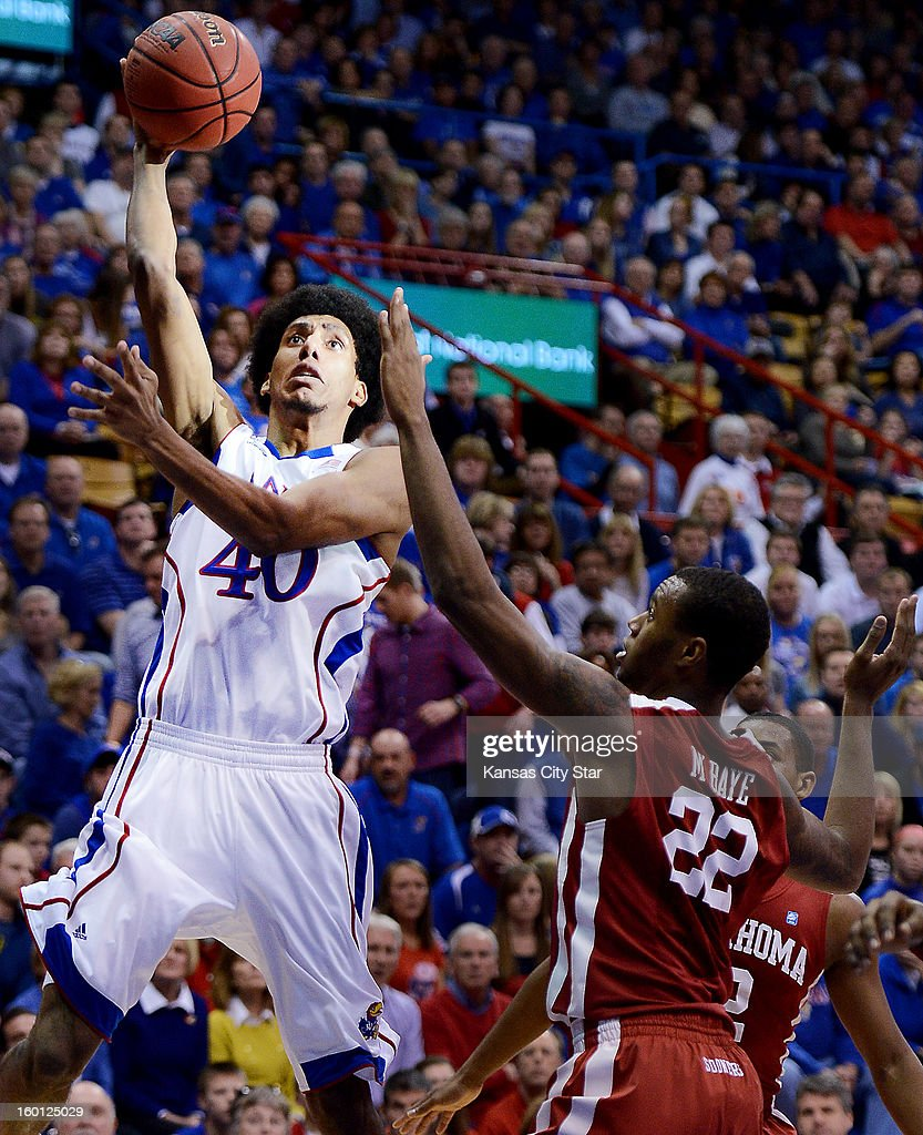 Kansas' Kevin Young (40) shoots over Oklahoma's Amath M'Baye during the second half at Allen Fieldhouse in Lawrence, Kansas, on Saturday, January 26, 2013. Kansas won, 67-54.
