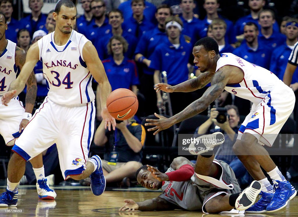 Kansas' Perry Ellis, left, and Naadir Tharpe rips the ball away from Washington State's Mike Ladd during the first half of the CBE Hall of Fame Classic at the Sprint Center on Monday, November 19, 2012, in Kansas City, Missouri.
