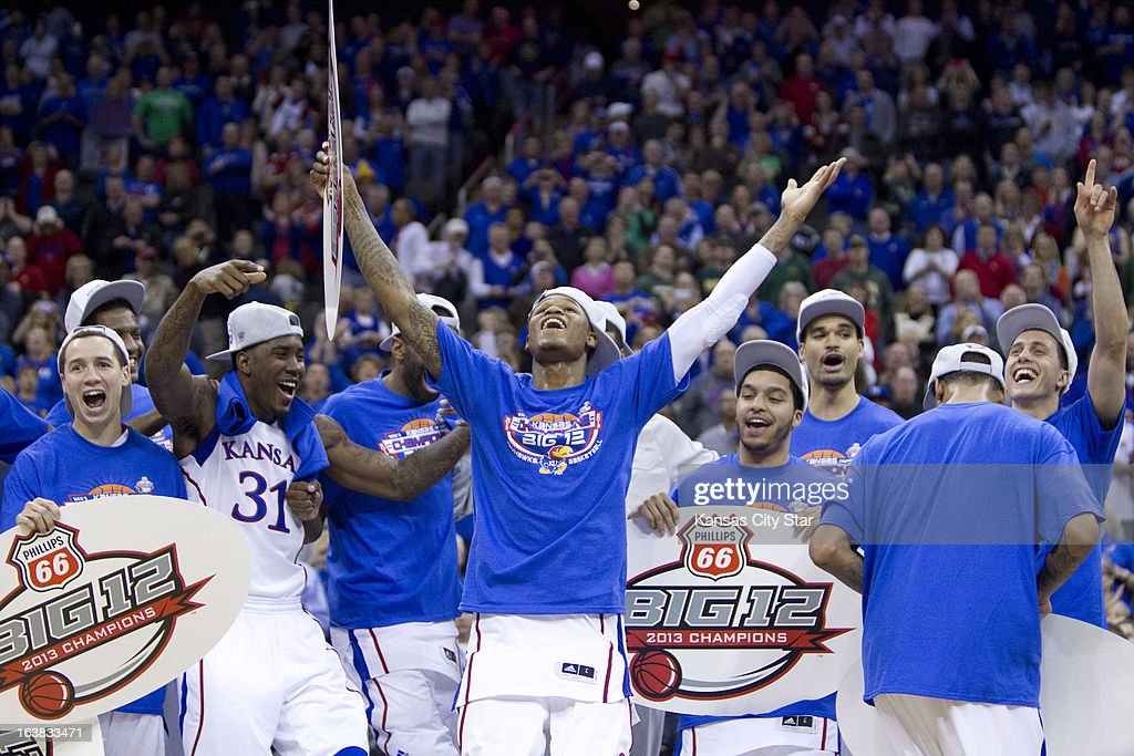 Kansas players celebrate a Big 12 Tournament championship after a 70-54 win against Kansas State at the Sprint Center in Kansas City, Missouri, on Saturday, March 16, 2013.