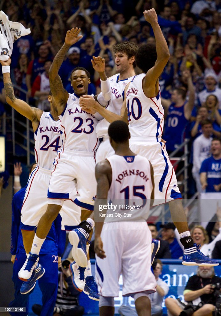 Kansas players celebrate a three-point shot by teammate Jeff Withey in the first half against Texas Tech at Allen Fieldhouse in Lawrence, Kansas, Monday, March 4, 2013. Kansas defeated Texas Tech, 79-42.