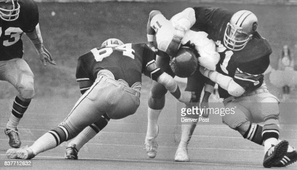 A 'SQUEEZE PLAY' BY BUFF DEFENDERS Kansas quarterback David Jaynes is dropped on this play by Coolrado's Bud Magrum and Lennie Ciufo Buffs scored 338...