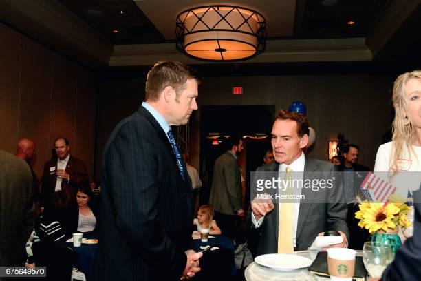 Kansas Secretary of State Kris Kobach listens an unidentified Republican supporter at an election night party Wichita Kansas April 11 2017