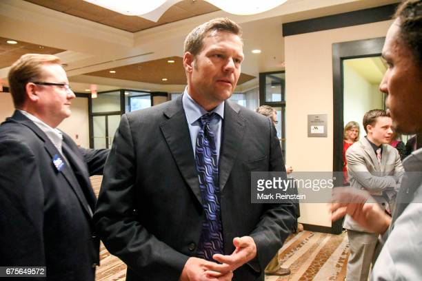 Kansas Secretary of State Kris Kobach listens to journalist John Eligon from the New York Times at an election night party Wichita Kansas April 11...
