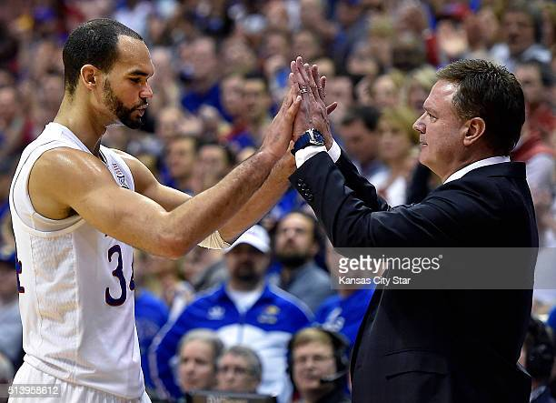 Kansas senior Perry Ellis exchanges highfives with head coach Bill Self as he leaves the court amid an 8578 win against Iowa State on Saturday March...