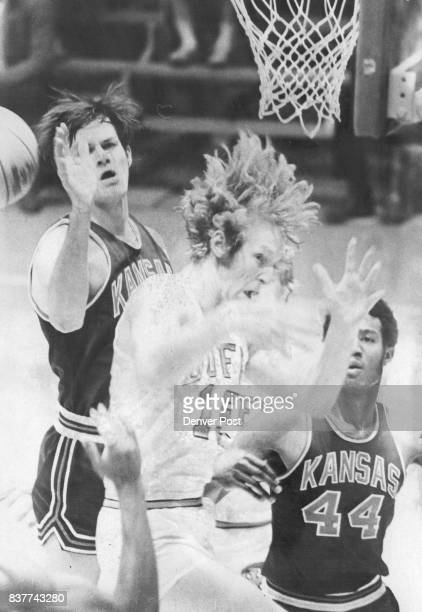 Kansas Shot Bounds Past Wouldbe Rebounders Jayhawk's Neal Mask Colorado's Lee Haven and KU's Wilson Barrow can't handle it Credit Denver Post Inc
