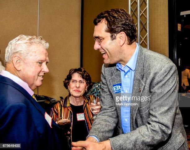 Kansas State Attorney General Derek Schmidt shakes hands with an unidentified Republican supporter at an election night party Wichita Kansas April 11...