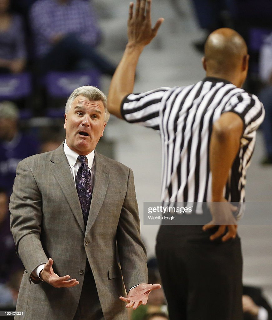 Kansas State coach Bruce Weber talks with the referee during the first half against Texas at Bramlage Coliseum in Manhattan, Kansas, on Wednesday, January 30, 2013.