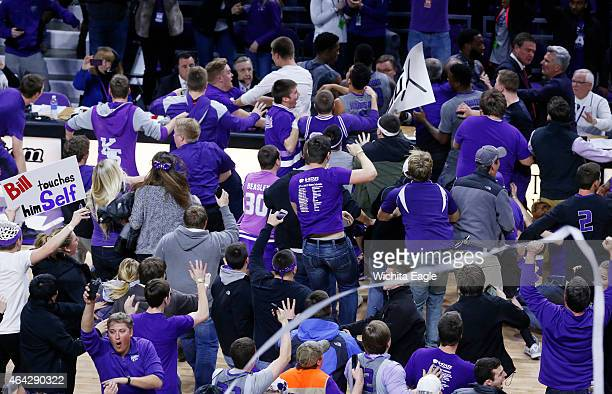 Kansas State fans and players celebrate after the team upset eighthrank Kansas on Monday Feb 23 at Bramlage Coliseum in Manhattan Kan