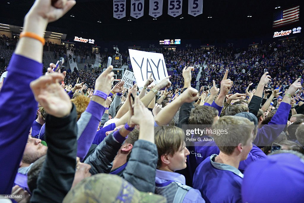 Kansas State fans storm the floor after the Kansas State Wildcats defeated the Kansas Jayhawks 7063 on February 23 2015 at Bramlage Coliseum in...