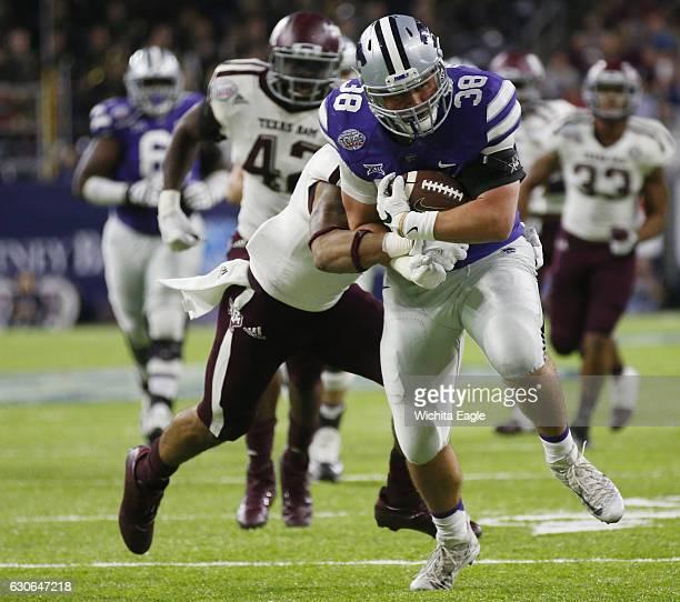 Kansas State fullback Winston Dimel churns down field dragging Texas AM defenders in the Texas Bowl at NRG Stadium in Houston on Wednesday Dec 28 2016
